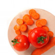 Carrots and tomato — Stock Photo