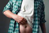 Man with a small belly — Stock Photo