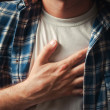 Chest pain - Stock Photo