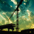 Construction crane in dusk - Stok fotoğraf