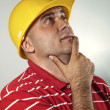 Young construction worker thinking — Stock Photo