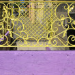 Foto Stock: Yellow grille at entrance to basement cafe