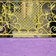 Стоковое фото: Yellow grille at entrance to basement cafe