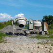 Cement mixers abandoned in field - no action, no work, nobody - Stock Photo