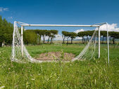 Football aka soccer pitch, unused, dilapidated — Stok fotoğraf