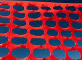 Safety barrier lattice pattern orange and blue sky — Stock Photo