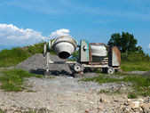 Cement mixers abandoned in field - no action, no work, nobody — Stock Photo