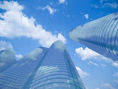 Skyscrapers with clouds reflection — Stock Photo