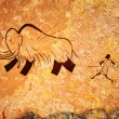 Cave painting of primitive hunt - Stock Photo