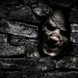 Stock Photo: Monster behind wall