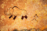 Cave painting of primitive hunt — ストック写真