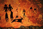 Cave painting of primitive commune — Stock Photo