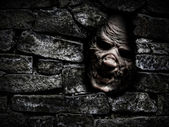 Monster behind the wall — Stock Photo