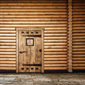 Wooden wall with door — 图库照片