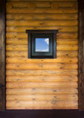 Wooden wall with window — Stockfoto
