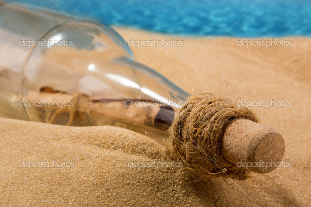 Message in a bottle on the beach — Stock Photo #11368876