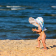 Little baby girl on the beach — Stock Photo