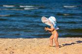 Little baby girl on the beach — Stock Photo