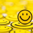 Yellow smiley magnet — Stock Photo