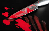 Knife in blood — Stock Photo