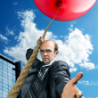 Businessman inviting you to fly up — Stock Photo