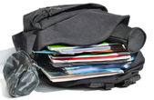 Well-filled schoolbag — Stock Photo