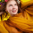 Girl with flowers in her hair — Stock Photo