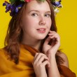 Stock Photo: A girl with a wreath of flowers