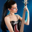 Girl holding a bass guitar — Stock Photo