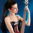 Foto Stock: Girl holding bass guitar