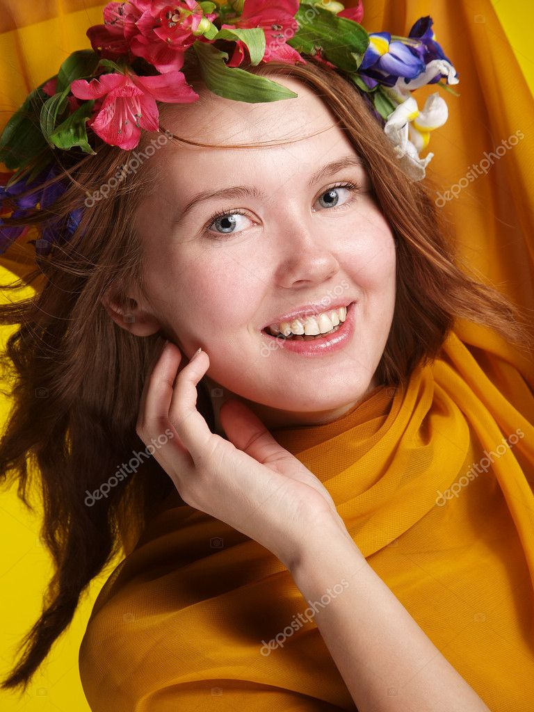 Smiling girl with flowers in her hair, wrapped in tissue — Stock Photo #10940770
