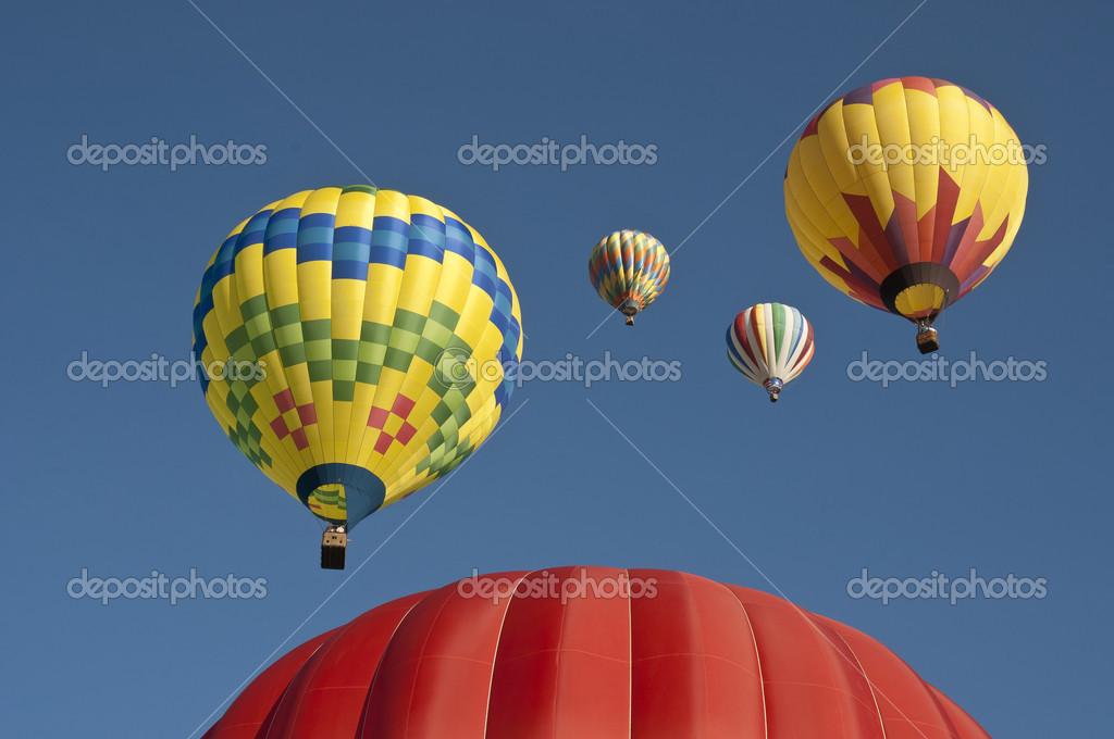 Looking at five balloons, one on the ground and four above — Stock Photo #11253370