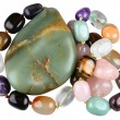 Nephrite and beads from semi-precious stones — Stock Photo