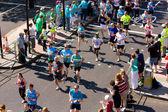 Boys run in the london marathon — Stock Photo