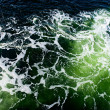 Deep green ominous ocean water background — Stock Photo