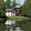 House and white lake at Crans Montana, by summer - Stock Photo