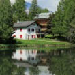 Stock Photo: House and white lake at Crans Montana, by summer