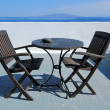 Table and chairs at Santorini, Greece — Stock Photo