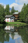 House and white lake at Crans Montana, by summer — Stock Photo