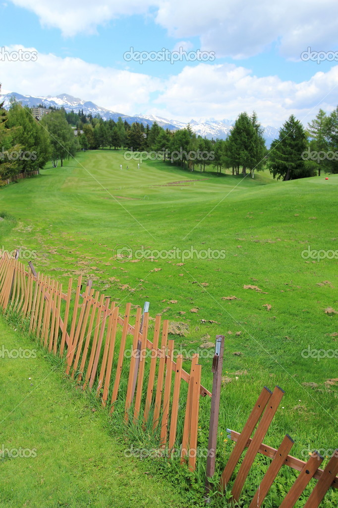 Golf course and fence by summer, Crans Montana, Switzerland  — Foto Stock #10932779