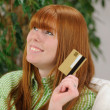 Young woman with credit card smiling — Stock Photo #10835152
