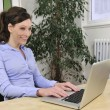 Green office: business woman working - Stock Photo