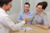 Financial advisor or lawyer and happy couple — Stock Photo