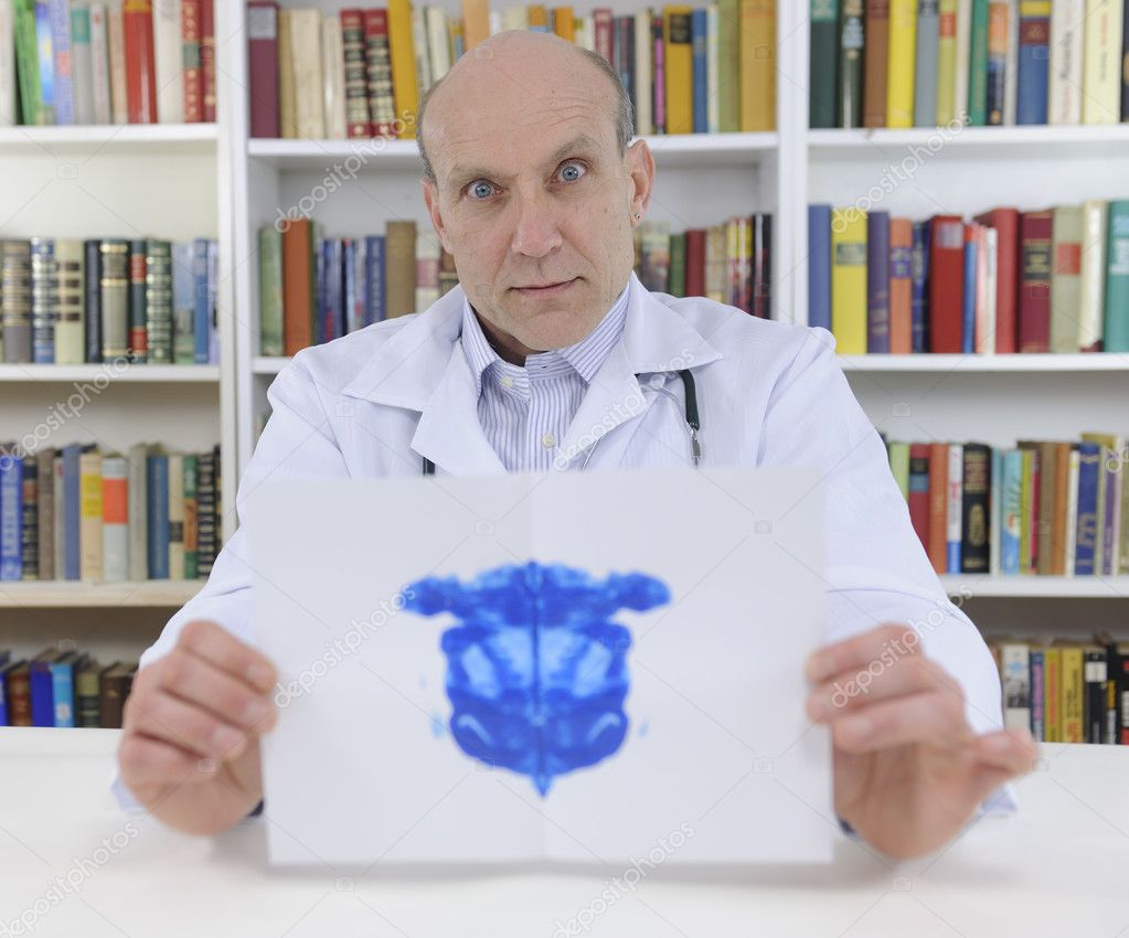 Psychotherapist holding Rorschach Test — Stock Photo #10835503