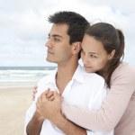 Hispanic couple bonding on beach — Stock Photo