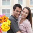 Stock Photo: Man surprising his girlfriend with a bouquet