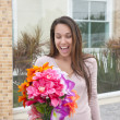 Man surprising his girlfriend with a bouquet — Stock Photo #10910868