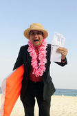Ready for a holiday: businessman on the beach — Stock Photo