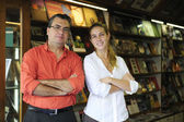 Family business partners owners of a small bookstore — Stock Photo