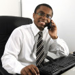 Happy businessmworking at desk smiling — Stock Photo #10955957